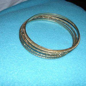 6 gold tone bracelets